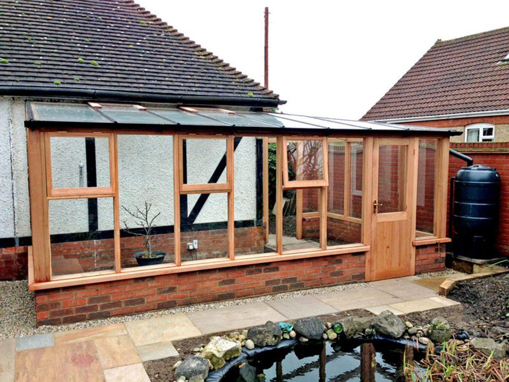 Timber Framed Glass Green House Construction